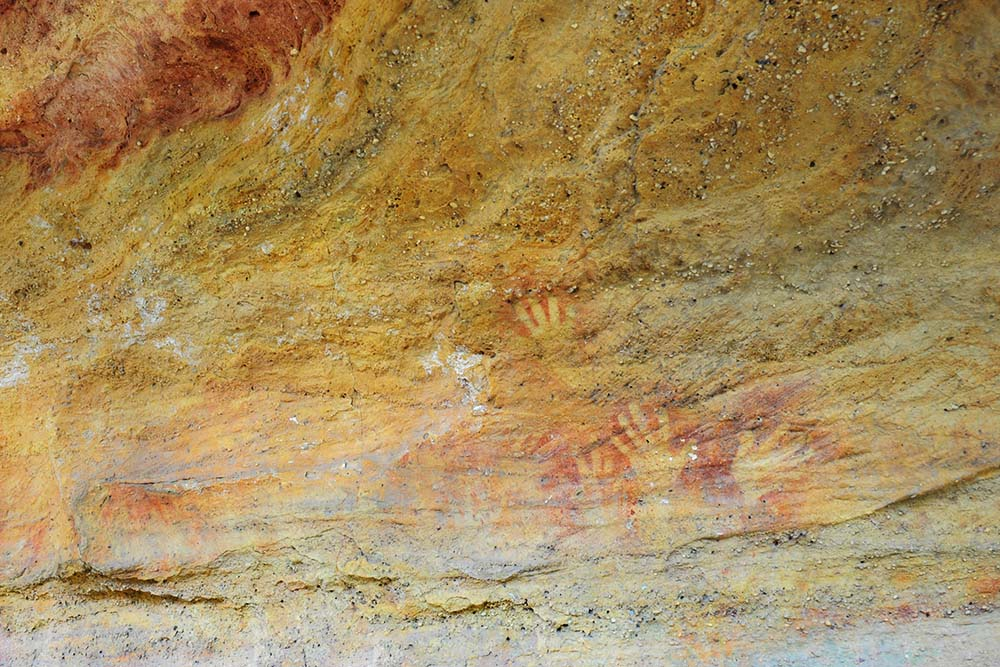 hands on rock aboriganal painting ulan nsw